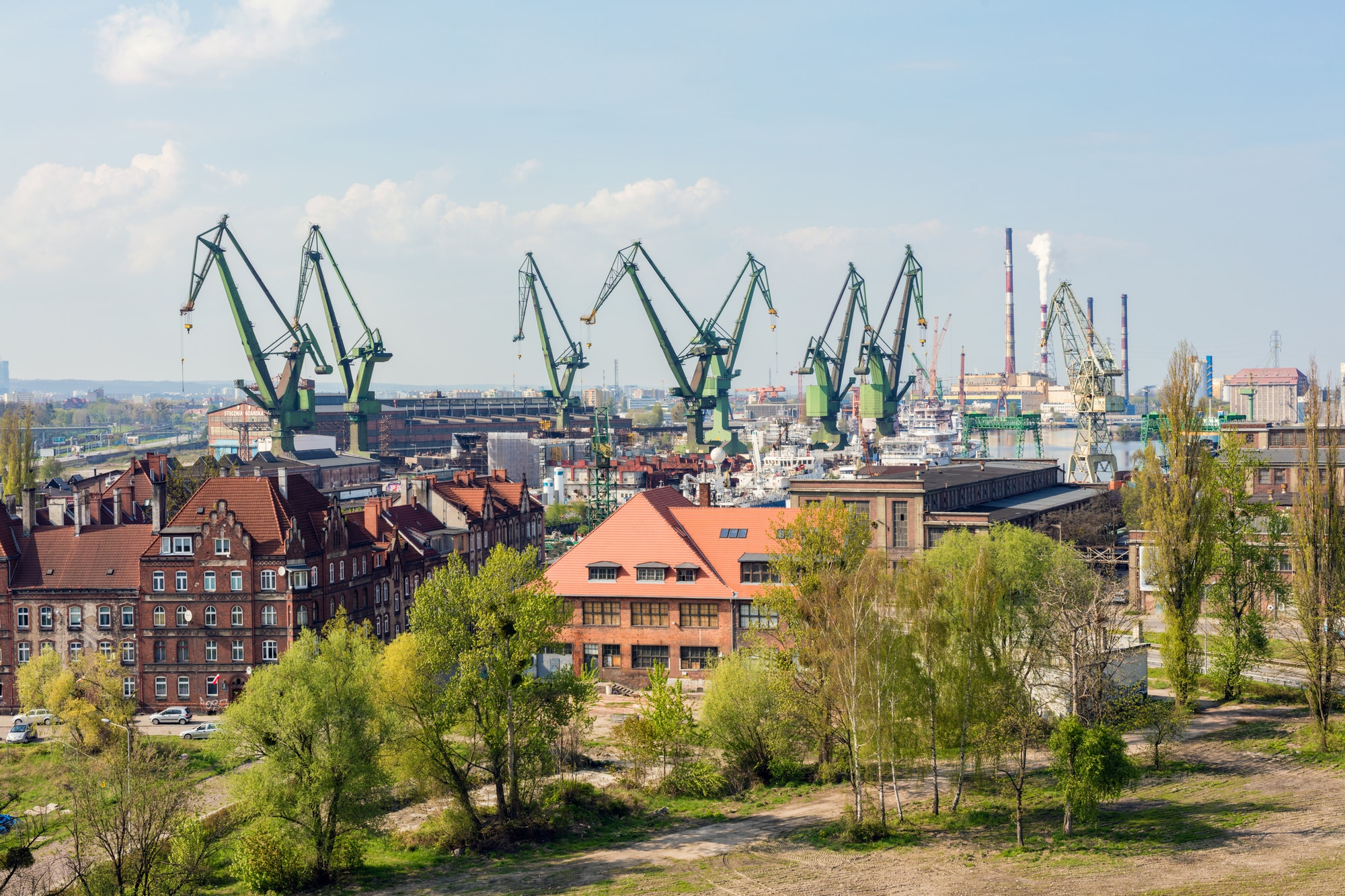 GDANSK, POLAND, May 14, 2018: A view of Gdansk shipyard and the green cranes.